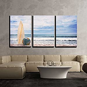 "wall26 - 3 Piece Canvas Wall Art - Surfboard and Ball on Empty Beach Against Blue Sky and Turquoise Ocean - Modern Home Decor Stretched and Framed Ready to Hang - 24""x36""x3 Panels"