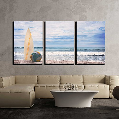 Surfboard and Ball on Empty Beach Against Blue Sky and Turquoise Ocean x3 Panels