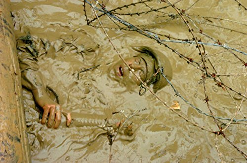 Posterazzi Poster Print Collection a Seabee Emerges from Muddy Water Under Razor and Barbed Wire Stocktrek Images, (17 x 11), Multicolored ()