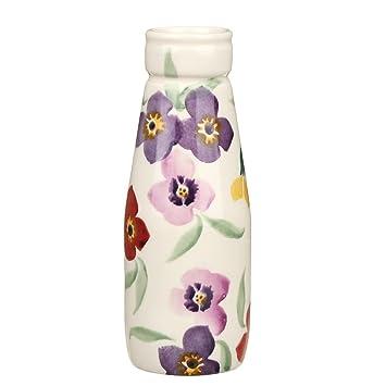 Flores pequeña botella de leche
