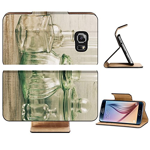 Luxlady Premium Samsung Galaxy S6 Edge Flip Pu Leather Wallet Case IMAGE 28447654 Collection of empty various glassware on vintage wooden background