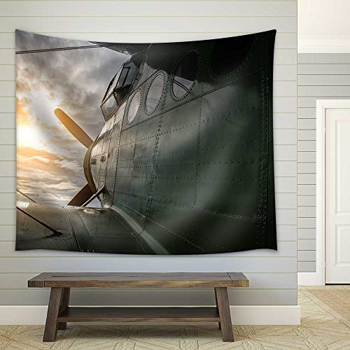 Old Aircraft Flying in a Cloudy Sky by Sunset Fabric Wall Tapestry