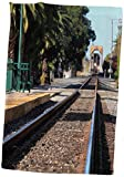 Ventura train station California with a view of the tracks and train. Towel is great to use in the kitchen, bathroom or gym. This 15 by 22 inch, hand/sports towel allows you to customize your room with a special design or color. Great for drying dish...