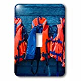3dRose Alexis Photography - Objects - Water safety goes first. Orange life saving jackets on a blue wall - Light Switch Covers - single toggle switch (lsp_267156_1)
