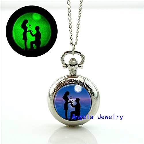 pretty-lee-fashion-couple-on-beach-glowing-pocket-watch-necklace-silhouette-glass-jewelry-glowing-ne