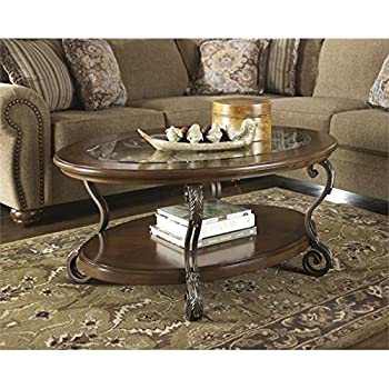 Ashley Furniture Signature Design   Nestor Glass Top Coffee Table    Cocktail Height   Oval