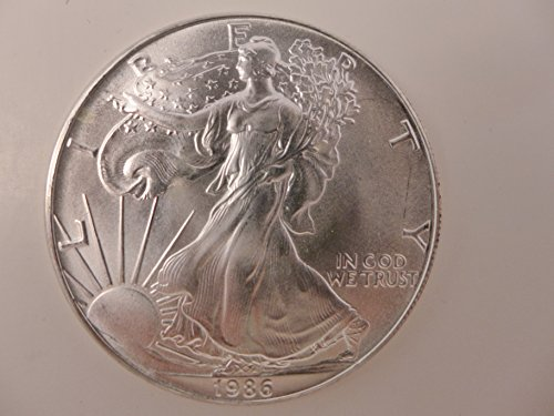 1986 First Issue (1986 American Eagle 1 oz. Silver Minor Spots / Toning First year of issue. Dollar Brilliant Uncirculated)