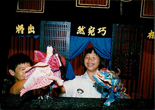 (Vintage photo of The puppet show is a popular folk art.)