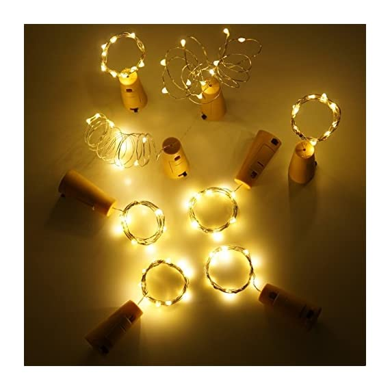 Wine Bottle Lights with Cork, LoveNite 15 Pack Battery Operated 10 LED Cork Shape Silver Wire Colorful Fairy Mini String… - 【Recycle Bottles With Romance】: Most Popular Warm White, 10 Super Bright Led Bulbs on a 40 Inches Long and Thin Sliver Wire. The low heat emission and eco-friendly design Cute Beautiful Bottle Cork String Lights Could Create Romantic, Peaceful and Warm Atmosphere After Decoration. 【Enjoy DIY FUN& for Many Occasion】: Made of High-quality Ultra Thin Silver Wire, can be Easily Designed to any DIY Shape You Like. Suitable Party, Wedding, Barbecue, Halloween, Christmas, Square, Garden, Indoor and Outdoor Decoration, etc. It is also a good gift for your Kids, Friends and Families. 【Battery Powered and More Saving】: Every Wine Bottle Cork Lights are Powered by 3 PCS LR44 Batteries (Batteries included) and no Need to Power Socket and Convenient to Use. The 10 led lights will Use Double Time than 20 led, while they have the Same Effect. A very Good Deal. - living-room-decor, living-room, home-decor - 516Rp29aFHL. SS570  -