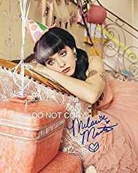 This item is a fantastic 11x14 glossy/matte finish poster photo, high quality, featuring the new and upcoming singer Melanie Martinez known for her hit songs titled Cry Baby and Dollhouse .? This fabulous photo features the reprinted autograph from?M...