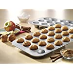 USA Pan Bakeware Mini Cupcake and Muffin Pan, 24 Well, Nonstick & Quick Release Coating, Made in the USA from Aluminized Steel 6 Mini Cupcake or Muffin Pan has 24 wells; commercial grade and heavy gauge aluminized steel with a lifetime warranty USA Pan baking pans feature Americoat which promotes quick release of baked-goods plus fast and easy clean up; wash with hot water, mild soap and gentle scrub brush or sponge Nonstick Americoat coating - a patented silicone coating which is PTFE, PFOA and BPA free - provides quick and easy release of all baked-goods and minimal easy clean up