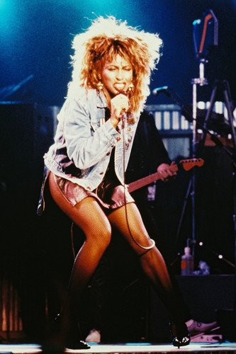 Tina Turner 24x36 Poster iconic denim jacket and short skirt in concert ()