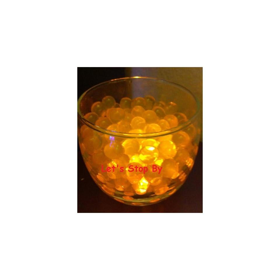 100g orange water bead + 6 pcs led amber waterproof mini light +3pcs LR41 batteries