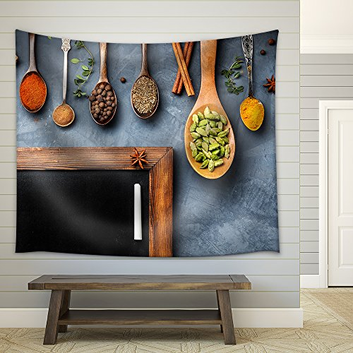 Various Spices Like Turmeric Cardamom Chili Ginger Star Anise and Cinnamon near Blackboard Fabric Wall Tapestry