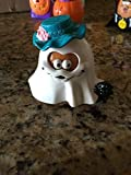 McBoo is wearing a white ghost costume with a teal colored hat. Her hat has the McDonalds M all the way around the hat band.  She also has a small black cat at her side.
