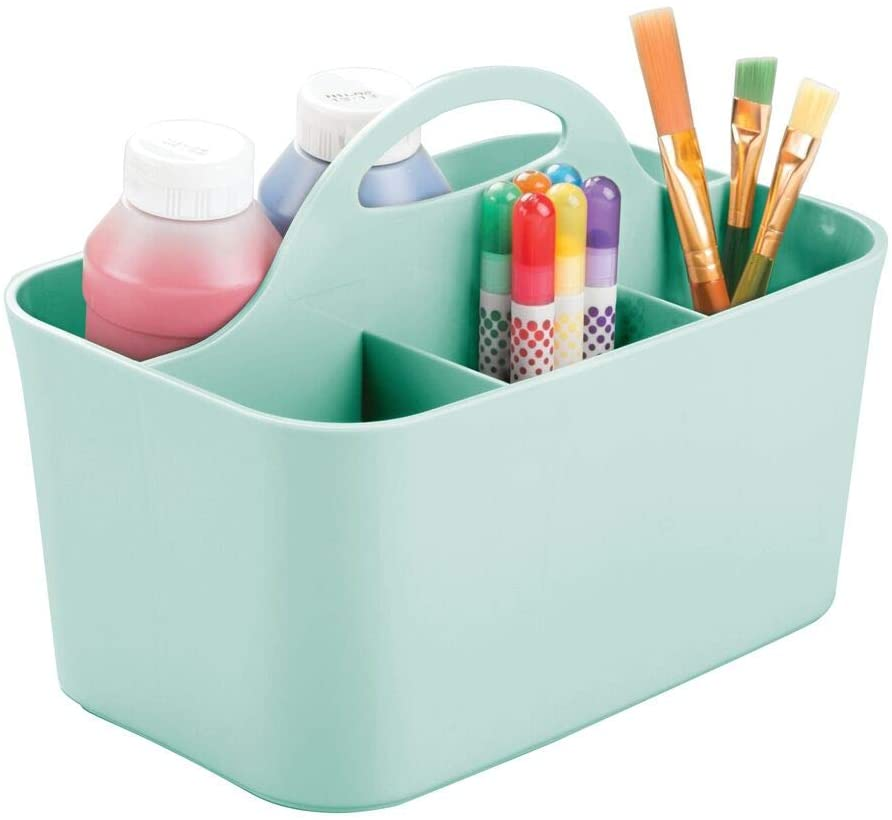 Blue storage caddie with paintbrushes, pens and paint in the pockets.