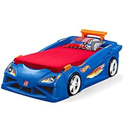 Mini racers will dream at 100mph in the Step2 Hot Wheels Toddler to Twin Bed with Lights. This kid's car bed will make the transition from a crib easy and fun. It grows with your child as it transforms into a twin bed. Kiddos will love showca...