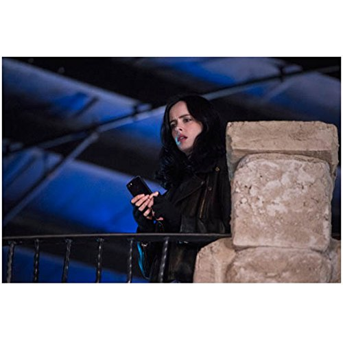 (Krysten Ritter 8 Inch x 10 Inch Photo Jessica Jones (TV Series 2015 -) Standing on Terrace Holding Phone Looking Downward kn)