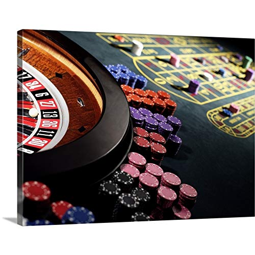 Premium Thick-Wrap Canvas Wall Art Print Entitled Gambling Chips Stacked Around Roulette Wheel on Gaming Table ()