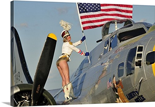 Christian Kieffer Premium Thick-Wrap Canvas Wall Art Print entitled 1940's style majorette pin-up girl on a B-17 bomber with an American flag 48''x32'' by Canvas on Demand