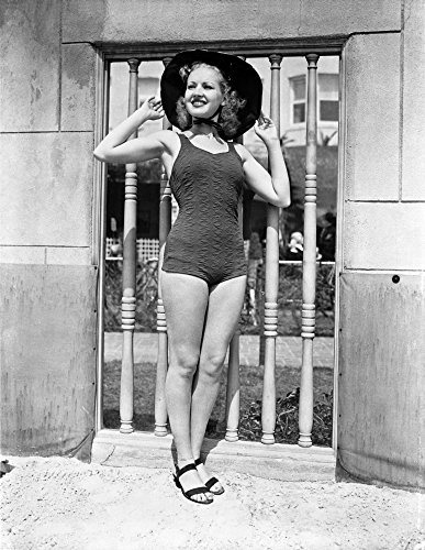 Posterazzi Poster Print Collection Betty Grable Posed with Hands Round Hat and One Piece Swimsuit with Black Flats Photo, (24 x 30), Multicolored