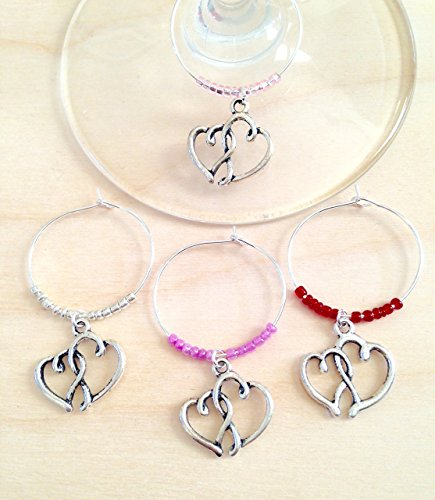 Interlocking hearts wine charm favors. Wine charms for engagement party favors, bridal shower favors, wedding favors for your guests. Add to wine glasses at event for elegant party ()