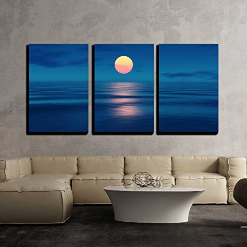 an Image of a Beautiful Sunset over the Ocean x3 Panels