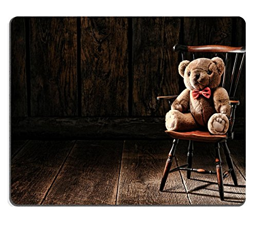 MSD Mousepad IMAGE 26583397 Vintage soft and fluffy teddy bear stuffed animal toy sitting on an old miniature Windsor style armchair in an antique house attic with wood plank floor and aged woo
