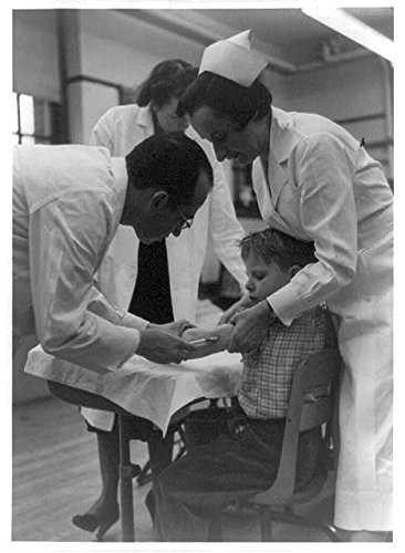 Nurses Assist (Photo: Dr. Jonas Salk innoculating a boy,as two nurses assist)