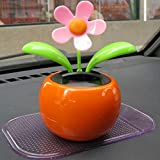 Feature:  Brand new and high quality.  Material: ABS plastic, solar panel  Application: Auto interior, Home decoration.  Size: 12*10.5cm.  Do not need batteries.  Package Included:  1 x Solar Dancing Flower Decoration.