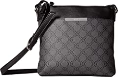 The Nine West® Moment Crossbody is sure to become the staple in your handbag collection. Faux-leather construction. Magnetic snap closure. Adjustable crossbody strap. Exterior boasts two zipper compartments and a front slip pocket. Flat bott...