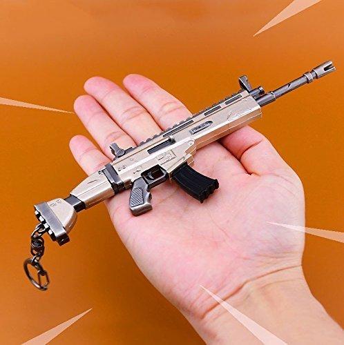 Amazon.com: Cozy Workshop Games - Llavero de metal, diseño ...