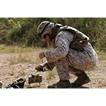 November 15 2006 - A US Marine places a claymore mine during an exercise at the Central Training Area to refresh the teams training with explosives Poster Print (16 x 11)