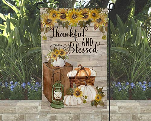 Thankful and Blessed Garden Flag with Pumpkins and Sunflowers over Distressed Wood Background 12x18]()