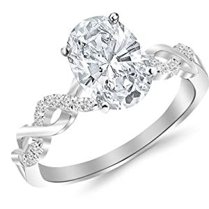 0.88 Carat t.w. Twisting Infinity Gold and Diamond Split Shank Pave Set Diamond Engagement Ring with a 3/4 Ct Forever Brilliant Oval Moissanite Center