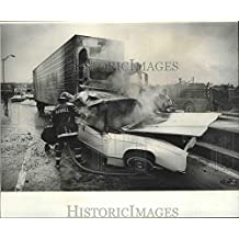 Historic Images 1976 Press Photo Accident - Firemen Pour Water on Car of Louis McMinn on I-10-8.25 x 10 in