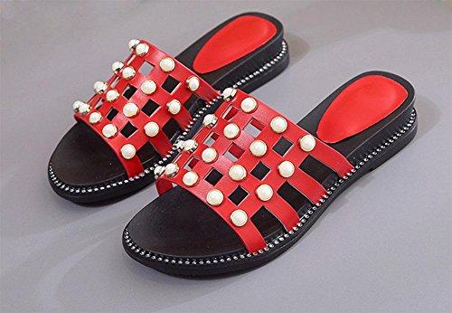 La primavera y el verano de moda salvaje remache arrastre plano la palabra fresco con antideslizantes de fondo grueso zapatillas las mujeres planas Red
