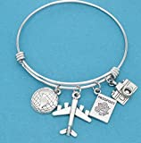 World traveler bangle bracelet in stainless steel with earth, airplane, passport and camera charms in silver tones. Gift for traveler.