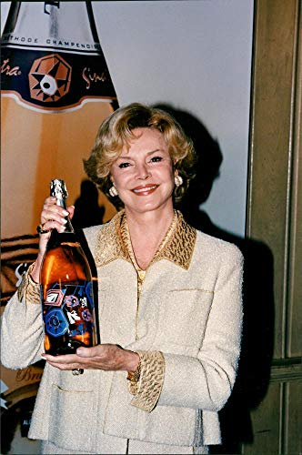 Vintage photo of Barbara Sinatra Displays The Geometrical Designs On The Sinatra-Korbel Champagne Bottle