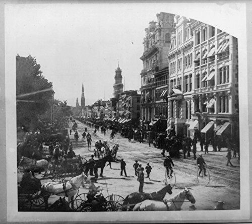 1885 Photo Connecticut bicycle parade at Hartford, Conn. view of Main St. looking north from Exchange Corner a parade of cyclists riding down the center of the street; spectators in ()