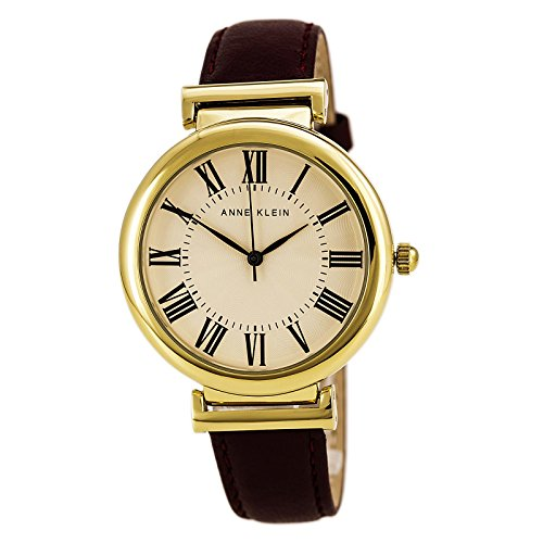 Anne Klein Women's AK/2136CRBY Gold-Tone and Burgundy Leather Strap Watch