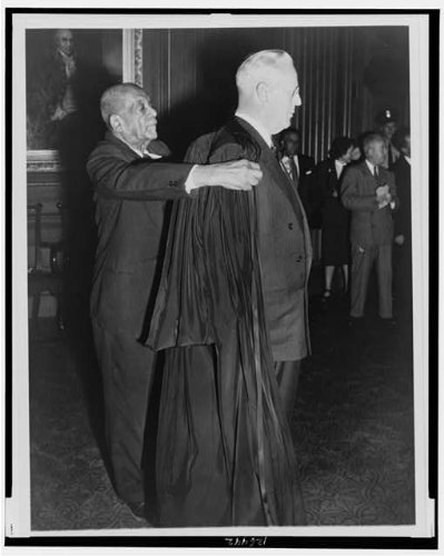 Court Robes (HistoricalFindings Photo: R.G. Marhsall helping Supreme Court Chief Justice Earl Warren w/Robe,1953)