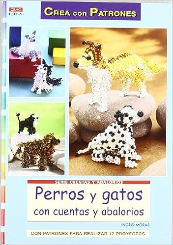 PERROS Y GATOS CON CUENTAS Y AB: MORAS INGRID: 9788498742213: Amazon.com: Books