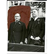 Vintage photo of France's Prime Minister Édouard Daladier and War Minister Leslie Hore-Belisha are watching the Paris parade at the 150th anniversary of the Storming of the Bastille