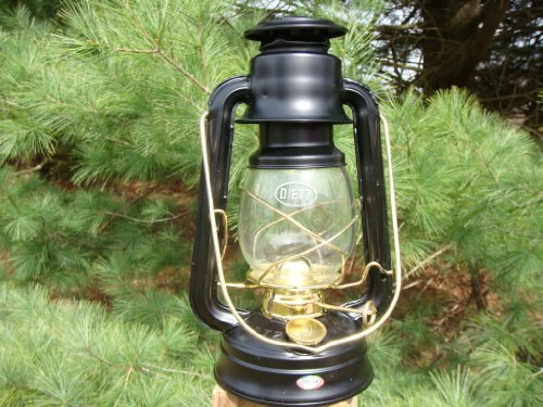 Amish Horse Buggy - Country Collectible Small Black Barn Lantern As Used in the Amish Buggy Light. Authentic Lanterns That Have Been Utilized for Decades to Light the Way on the Farms in the Amish Community. This Lantern Fits Perfectly Into the Amish Horse Buggy Carriage Lantern Light Box, That Fits Onto the Left Side of the Buggy for Safety. Magnificent and Functional, What More Could You Ask For? The Barn Lantern Measures 10 1/4 Inches Tall, Base Is 4 1/2 Inches Wide, and the Widest Point Is About 6 1/4 Inches.