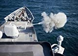 Home Comforts A Mark 32 MOD 4 5-inch gun fires off rounds during a live-fire exercise aboard the guided-missile cr