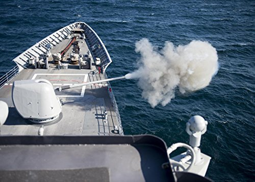 Home Comforts A Mark 32 MOD 4 5-inch gun fires off rounds during a live-fire exercise aboard the guided-missile cr by Home Comforts