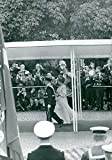 Vintage photo of People gathered to take photographs of Margrethe II of Denmark and Henrik, Prince Consort of Denmark.