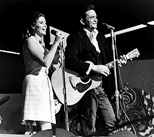 Johnny Cash and June Carter on stage