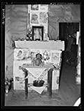Fireplace closed with screen decorated with newspapers in temporary home of FSA (Farm Security Administration) clients near Transylvania, Louisiana